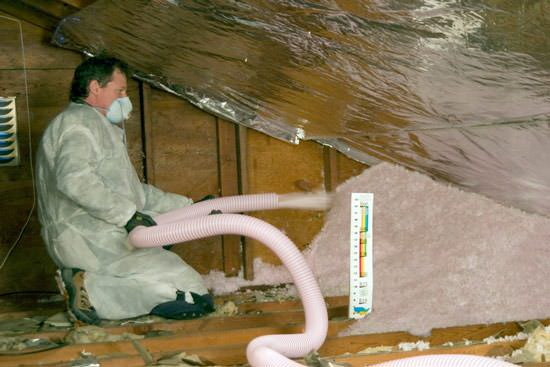 Fiberglass Insulation being used to add energy efficiency to an attic in Ocala & Attic Insulation Contractor The Villages Ocala Eustis Leesburg ...